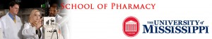 Pharmacy lab banner 1 with pharmacy students in white coats looking at a piece of equipment